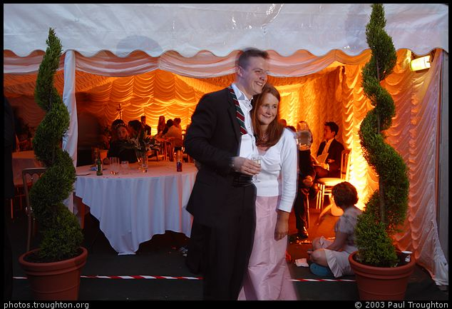 Posing for a photo in Walnut Tree Court - Queens' May Ball 2003