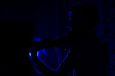 Sharon Sullivan, electric violin, in the dark - Eclectic Cabaret at Cafe Afrika, December 2004